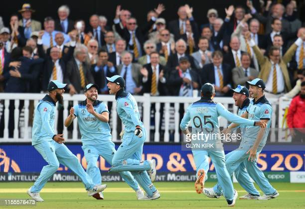 England's Jos Buttler celebrates with teammates after they won the super over to win the 2019 Cricket World Cup final between England and New Zealand...