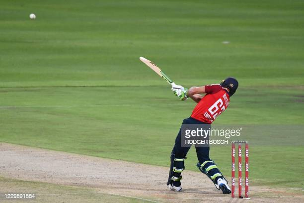 England's Jos Buttler hits a six during the third T20 international cricket match between South Africa and England at Newlands stadium in Cape Town,...