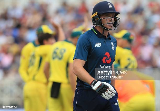 England's Jos Buttler leaves the crease with 11 after being caught out by Australia's Aaron Finch off the bowling of Australia's Kane Richardson...