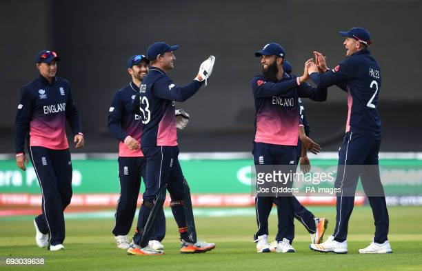 England's Jos Buttler Moeen Ali and Alex Hales celebrate taking the wicket of New Zealand's Ross Taylor during the ICC Champions Trophy Group A match...