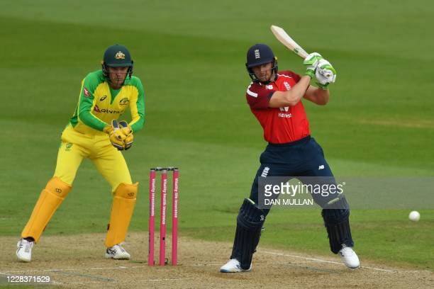England's Jos Buttler plays a shot as Australia's wicket keeper Alex Carey keeps wicket during the international Twenty20 cricket match between...
