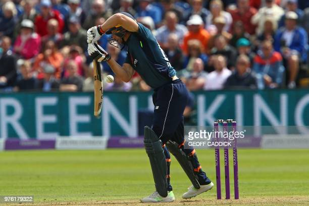 England's Jos Buttler plays a shot during play in the 2nd One Day International cricket match between England and Australia at Sophia Gardens cricket...