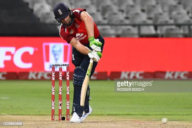 England's Jos Buttler plays a shot during the third T20 international cricket match between South Africa and England at Newlands stadium in Cape...