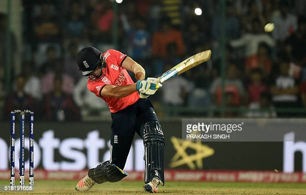 TOPSHOT England's Jos Buttler plays a shot during the World T20 cricket tournament first semifinal match between England and New Zealand at The Feroz...