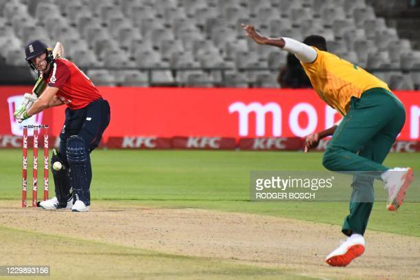 England's Jos Buttler plays a shot from a ball delivered bt South Africa's Lungi Ngidi during the third T20 international cricket match between South...