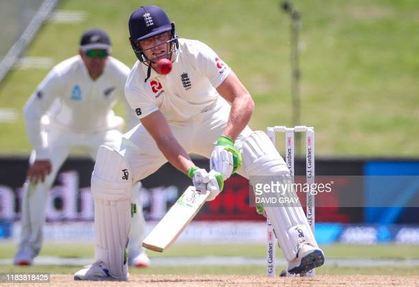 England's Jos Buttler prepares to play a shot as he bats during the second day of the first cricket test between England and New Zealand at Bay Oval...