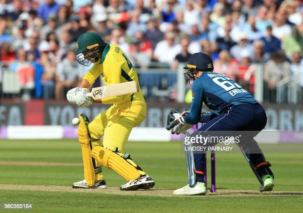 England's Jos Buttler prepares to take the wicket of Australia's Ashton Agar for 18 runs during the fourth One Day International cricket match...