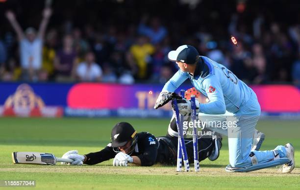 England's Jos Buttler runs out New Zealand's Martin Guptill to win the superover to win the 2019 Cricket World Cup final between England and New...