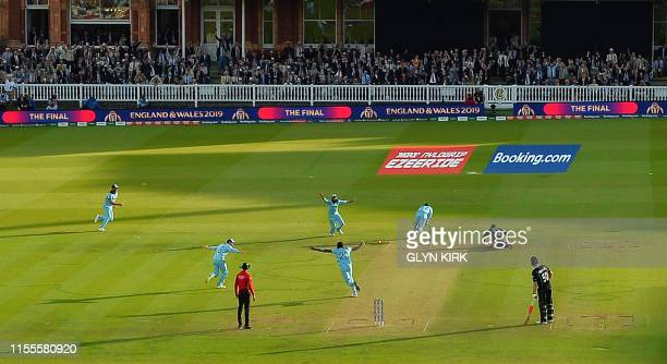 England's Jos Buttler runs out New Zealand's Martin Guptill to win the super-over to win the 2019 Cricket World Cup final between England and New...
