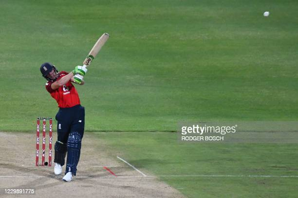 England's Jos Buttler watches the ball after playing a shot during the third T20 international cricket match between South Africa and England at...