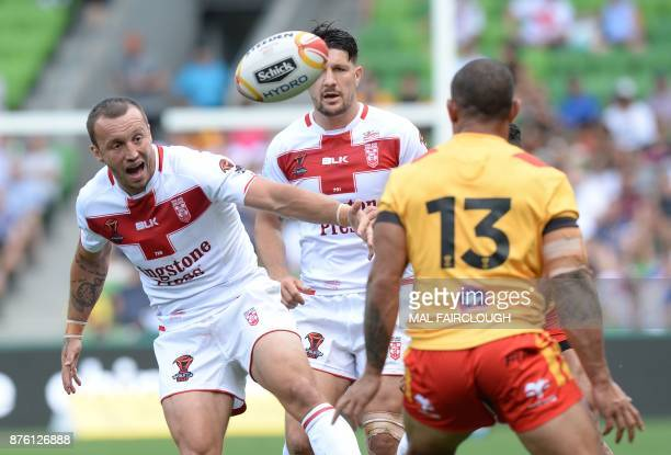 Englands Josh Hodgson makes a pass during their Rugby League World Cup quarterfinal match between England and Papua New Guinea in Melbourne on...