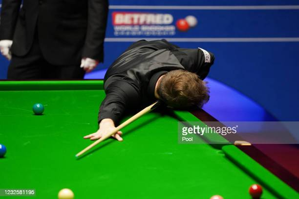 England's Judd Trump looks dejected during day 12 of the Betfred World Snooker Championships 2021 at Crucible Theatre on April 28, 2021 in Sheffield,...
