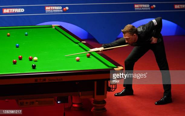 England's Judd Trump plays a shot during day 12 of the Betfred World Snooker Championships 2021 at Crucible Theatre on April 28, 2021 in Sheffield,...