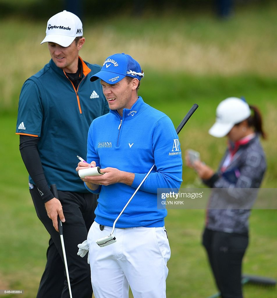 England's Justin Rose (L) and England's Danny Willett together during practice on July 12, 2016, ahead of the 2016 British Open Golf Championship at Royal Troon in Scotland. The 2016 British Open begins on July 14, 2016. / AFP / GLYN
