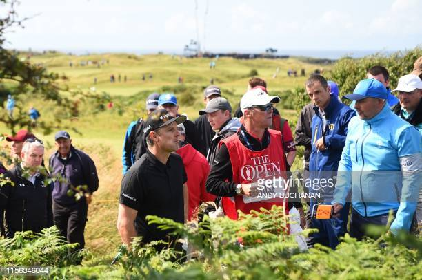 England's Justin Rose searches for his ball on the 4th hole during the first round of the British Open golf Championships at Royal Portrush golf club...