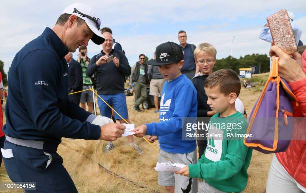 England's Justin Rose signs autographs during preview day four of The Open Championship 2018 at Carnoustie Golf Links Angus