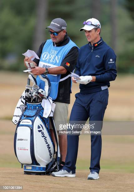 England's Justin Rose with his caddie during preview day four of The Open Championship 2018 at Carnoustie Golf Links Angus