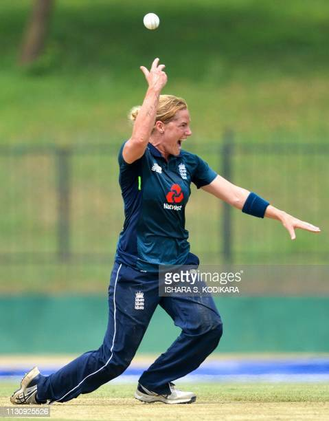 England's Katherine Brunt celebrates after taking a catch to dismiss Sri Lanka's Harshitha Madavi during the first one day international cricket...
