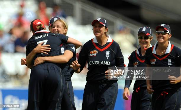 England's Katherine Brunt celebrates with Laura March after bowling out Aimee Watkins during the Final of the Womens ICC World Twenty20 at Lords...