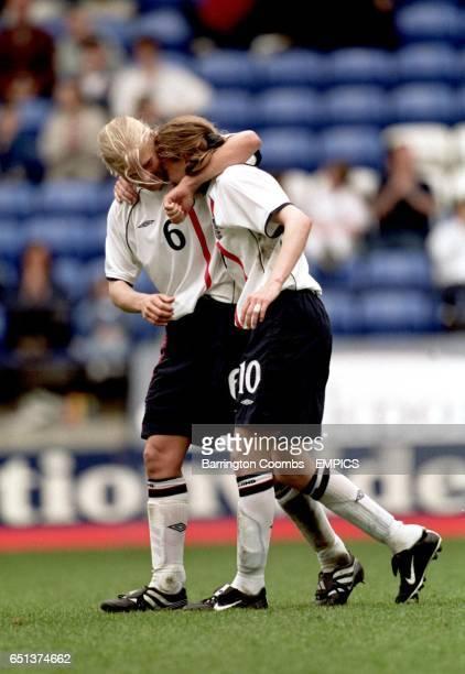 England's Katie Chapman congratulates teammate Angela Banks on scoring the winning goal