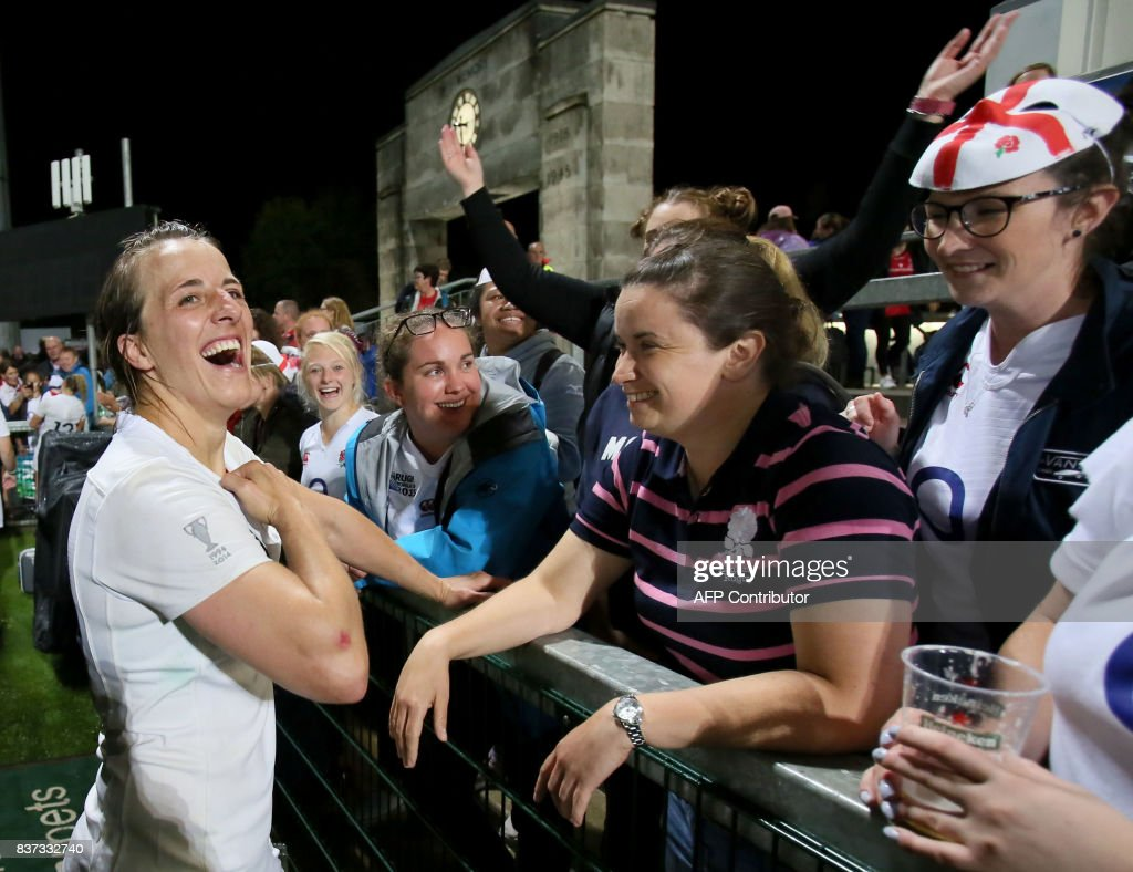 England's Katy Mclean celebrates victory with supporters after the Women's Rugby World Cup 2017 semi-final match between England and France at The Kingspan Stadium in Belfast on August 22, 2017. England beat France 20-3. / AFP PHOTO / Paul FAITH / RESTRICTED