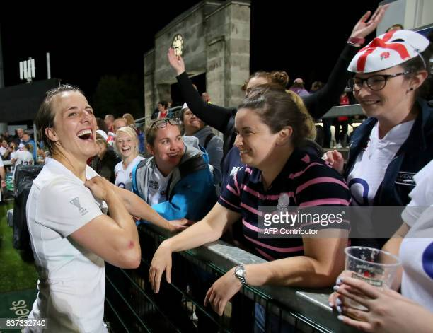 England's Katy Mclean celebrates victory with supporters after the Women's Rugby World Cup 2017 semifinal match between England and France at The...