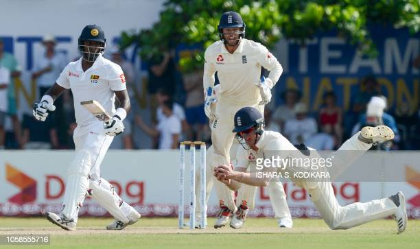 England's Keaton Jennings takes a catch to dismiss Sri Lanka's Angelo Mathews as Ben Foakes looks on during the second day of the opening Test match...