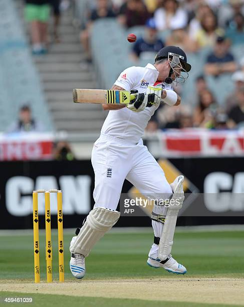 England's Keven Pietersen ducking away from a bouncer by Mitchell Johnson on the second day of the fourth Ashes cricket Test match against Australia...