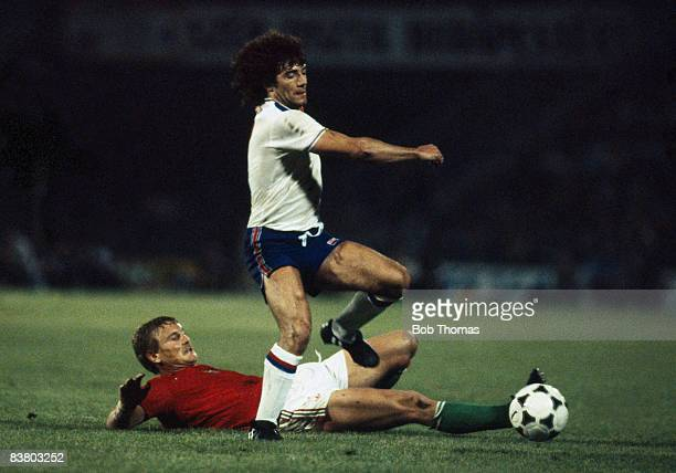 England's Kevin Keegan evades Hungarian defender Imre Garaba during the World Cup Qualifying Match at the Nep Stadium in Budapest 6th June 1981...