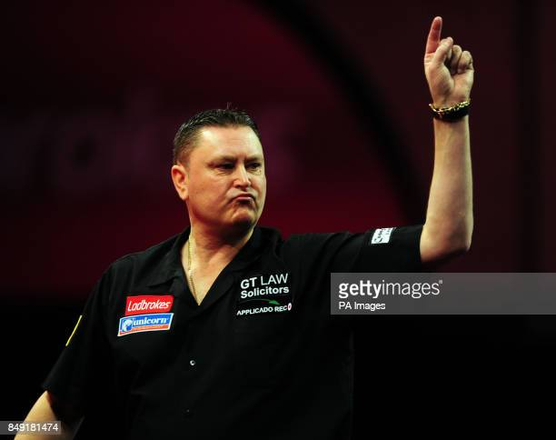 England's Kevin Painter celebrates taking the first set against Hong Kong's Leung Chun Nam during the Ladbrokescom World Darts Championship at...
