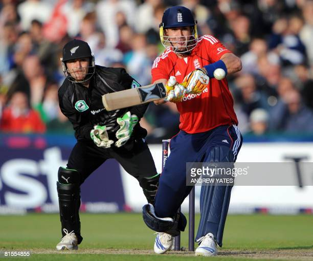 England's Kevin Pietersen scores runs watched by New Zealand wicketkeeper Brendon McCullum during the International Twenty20 cricket match against...
