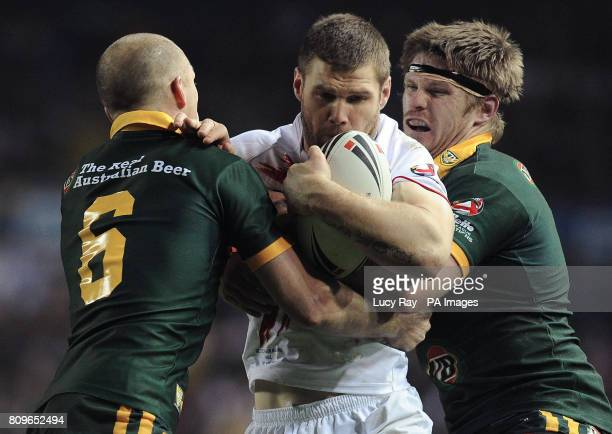 England's Kirk Yeaman gets tackled by Australia's Darren Lockyer and Chris Lawrence during the Four Nations Final match at Elland Road Leeds