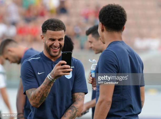 England's Kyle Walker takes a photo of fellow teammate Dele Alli before the 2018 FIFA World Cup group F qualifying football match between Malta and...