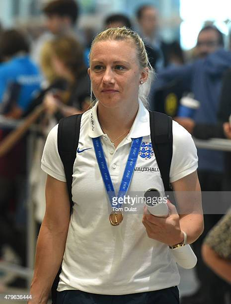 England's Laura Bassett arrives back from the World Cup at Heathrow Airport on July 6 2015 in London England