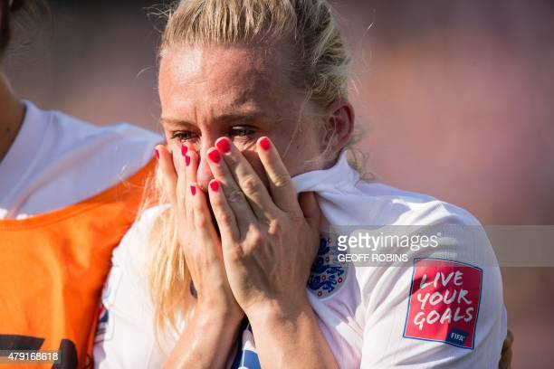 England's Laura Bassett weeps after she scored an owngoal in the last minutes of the game giving Japan the win in their semifinal match at the FIFA...