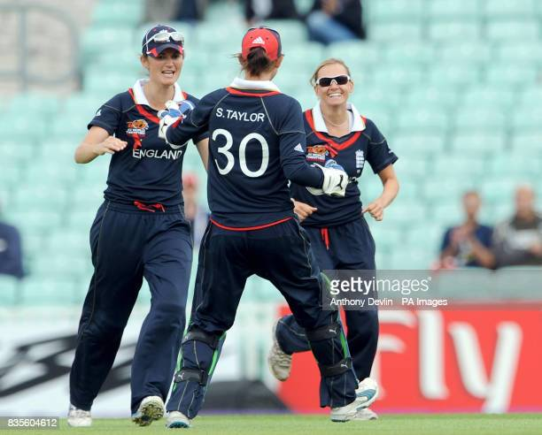 England's Laura Marsh celebrates with teammates after bowling out Australia's Leah Poulton during the ICC Women's World Twenty20 Semi Final at The...