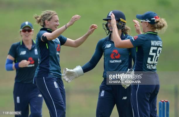 England's Laura Marsh celebrates with teammates after dismissing Sri Lanka's captain Chamari Atapattu during the second one day international women's...