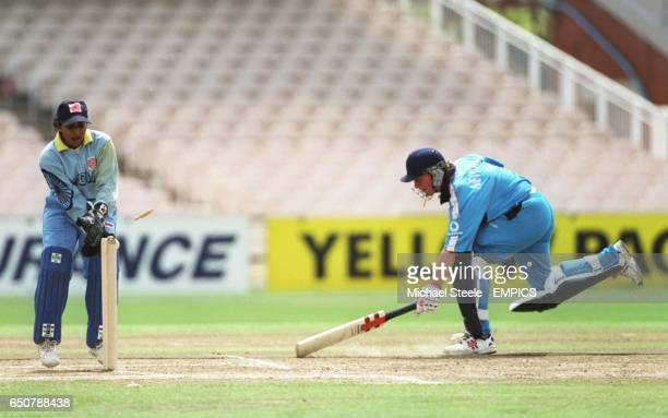 England's Laura Newton is run out by a direct throw by India's Anjun Chopra as wicketkeeper Anju Jain looks on