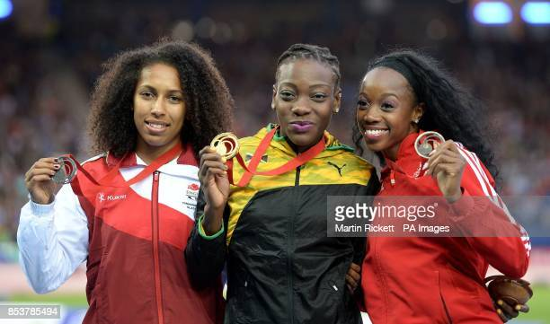 England's Laura Samuel with her silver medal Jamaica's Kimberly Williams with her gold medal and Trinidad and Tobago's Ayanna Alexander with her...