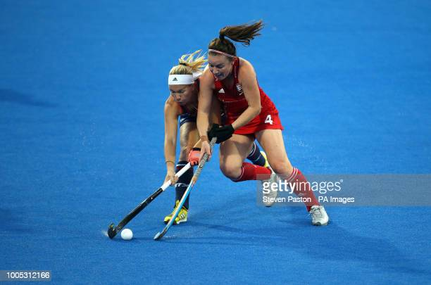 England's Laura Unsworth and United States Nicole Woods during the national Vitality Women's Hockey World Cup match at The Lee Valley Hockey and...