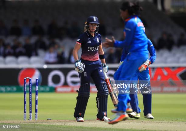 England's Lauren Winfield walks off after being bowled by India's Rajeshwari Gayakwad during the ICC Women's World Cup Final at Lord's London