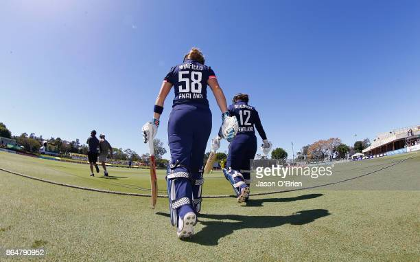 England's Lauren Winfield walks out to bat during the Women's One Day International between Australia and England at Allan Border Field on October 22...