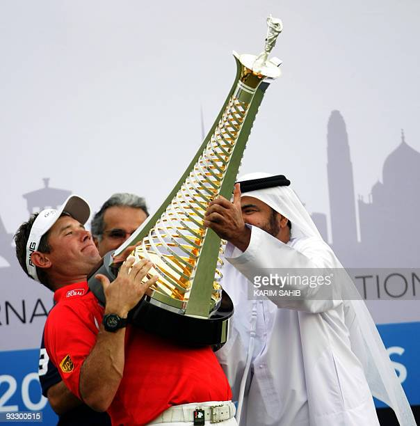 England's Lee Westwood raises his trophy after winning the Dubai World Championship at the Earth Course at Jumeirah Golf Estates in Dubai on November...