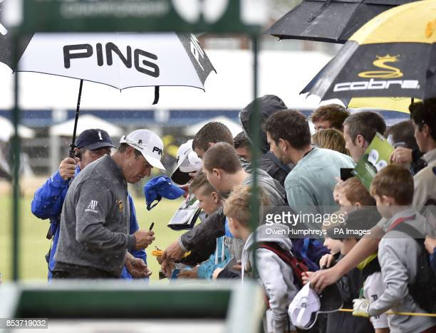 England's Lee Westwood signs autographs in the rain during practice day four of the 2014 Open Championship at Royal Liverpool Golf Club Hoylake