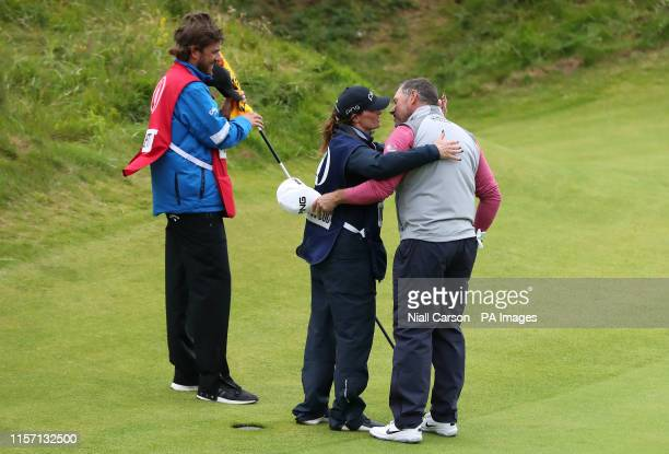 England's Lee Westwood with caddy and girlfriend Helen Storey after the 18th during day four of The Open Championship 2019 at Royal Portrush Golf Club