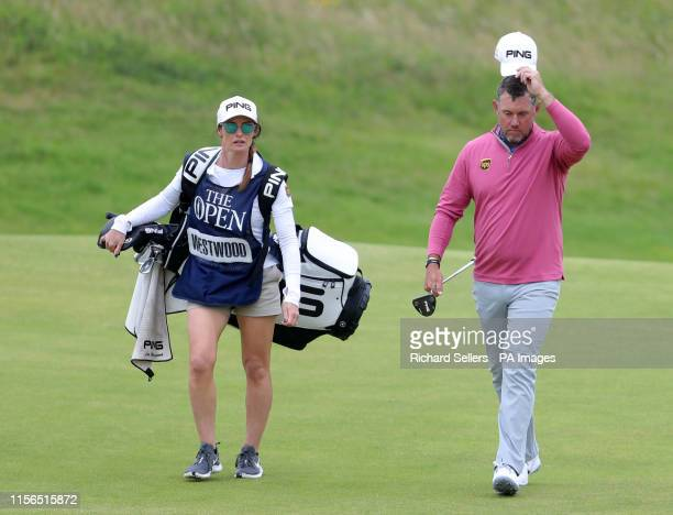 England's Lee Westwood with girlfriend and caddie Helen Storey on the 18th during day two of The Open Championship 2019 at Royal Portrush Golf Club