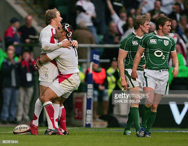 England's Left Wing Lesley and Centre Matthew Tait celebrate Tait's try during their Six Nations Rugby Union Championship match against Ireland at...