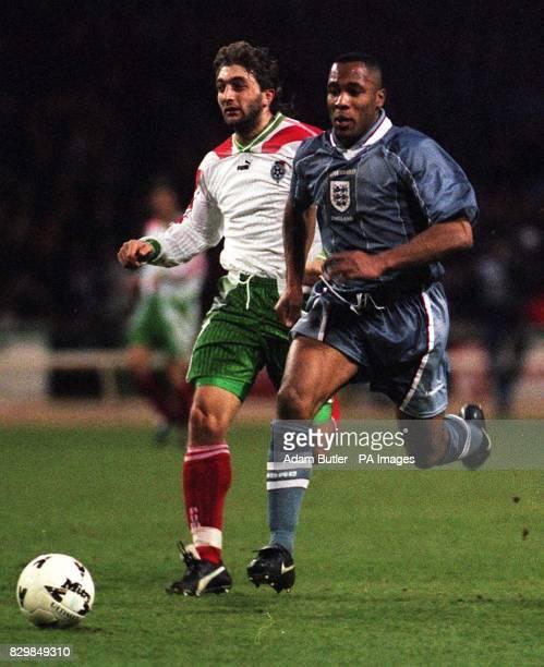 England's Les Ferdinand bursts past the Bulgarian defender Trifon Ivanov during tonight's friendly international at Wembley that England won 10