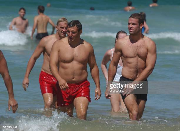 England's Lewis Moody Julian White and Joe Worsley in the water on Manly Beach England play Australia in the Rugby World Cup Final at the Telstra...