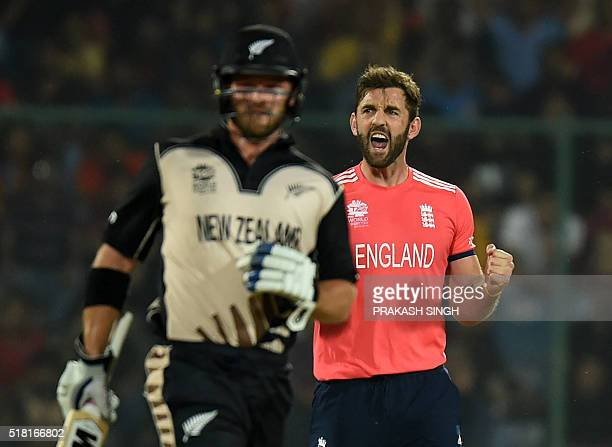 England's Liam Plunkett celebrates after his dismissal of New Zealand's Colin Munro during the World T20 cricket tournament semifinal match between...